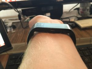 Since the screen isn't curved to match your wrist, it protrudes slightly.